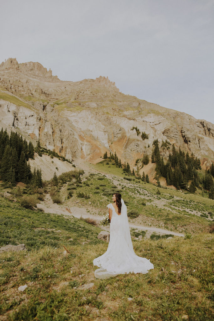 Emily is wedding dress in the mountains near Ouray, Colorado