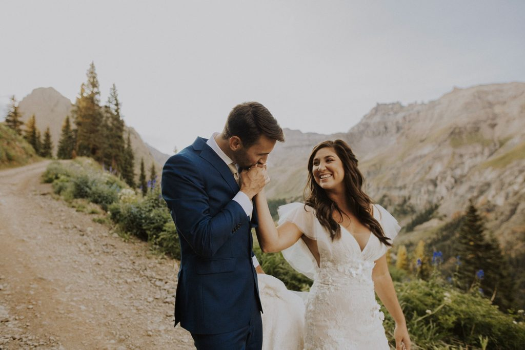 young couple getting married on a mountain.