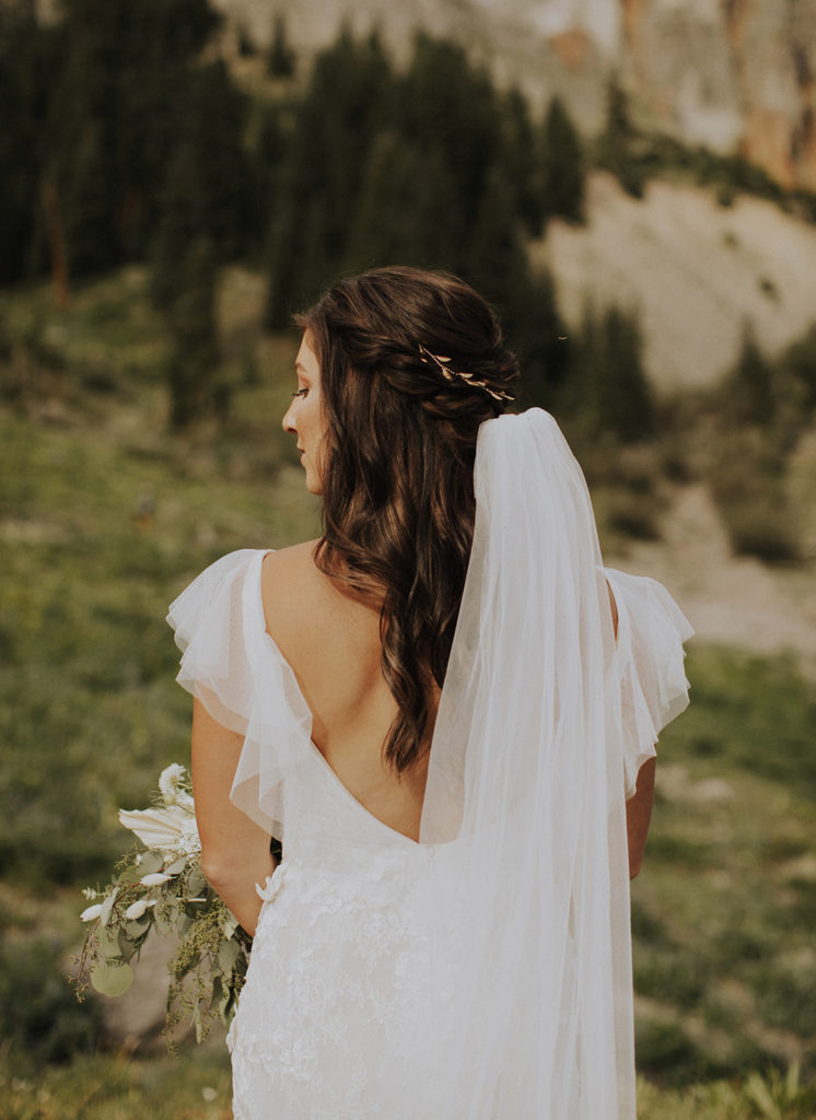 young woman in colorado showing the back of her wedding dress. Tips for finding the perfect wedding dress