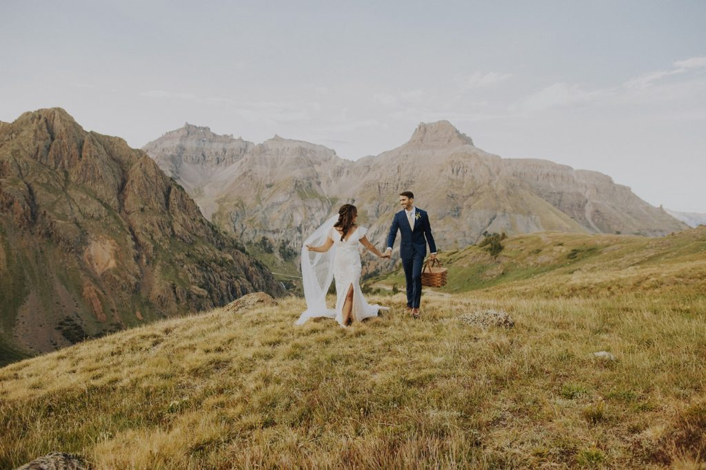 Couple getting married in the mountains near Ouray, Colorado. Tips for picking the perfect wedding dress