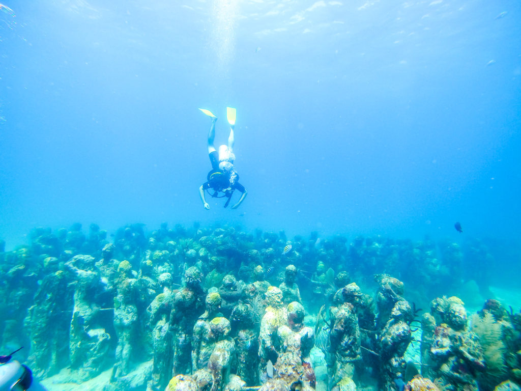 Man diving the Cancun Underwater Museum