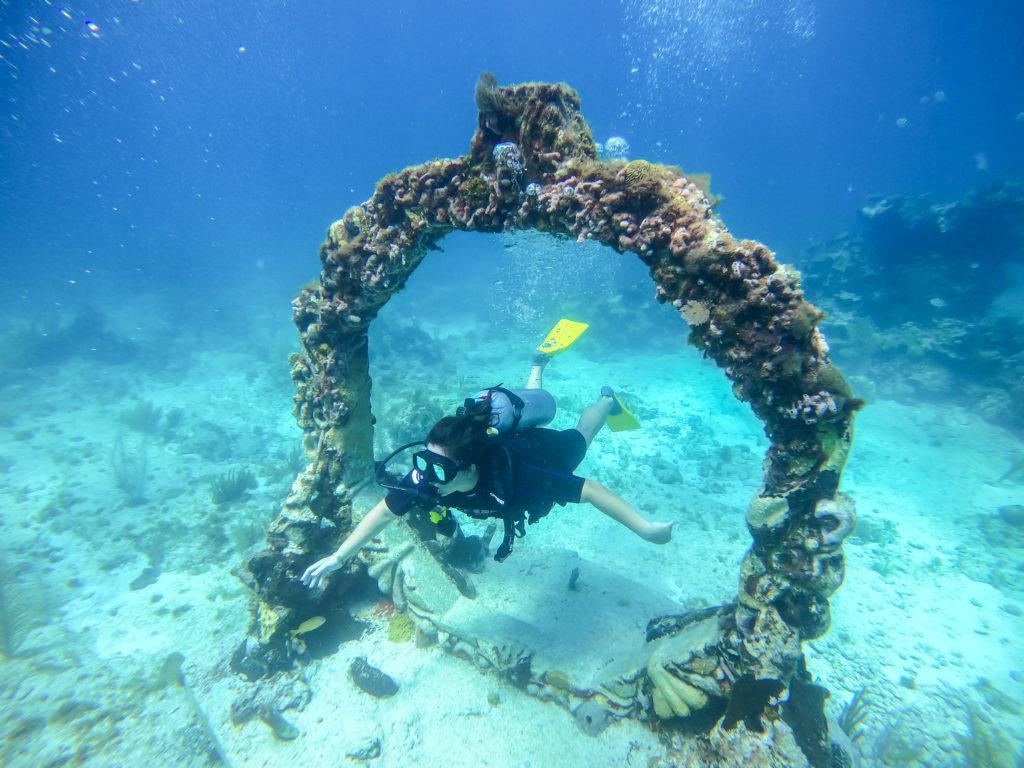 Girl scuba diving in cancun