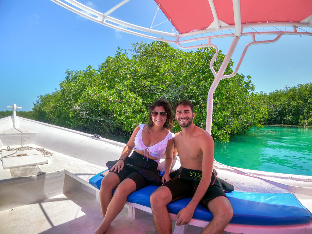 Couple on the boat in Cancun Mexico. Going to dive the Cancun Underwater Museum also known as MUSA