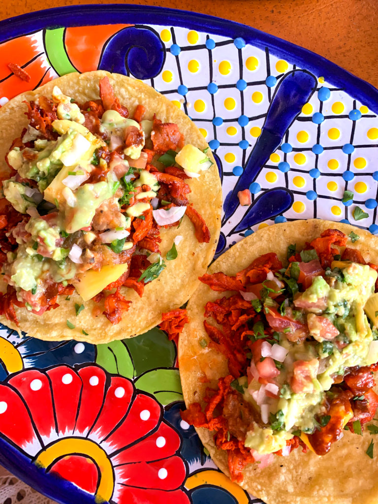 tacos on a colorful plate
