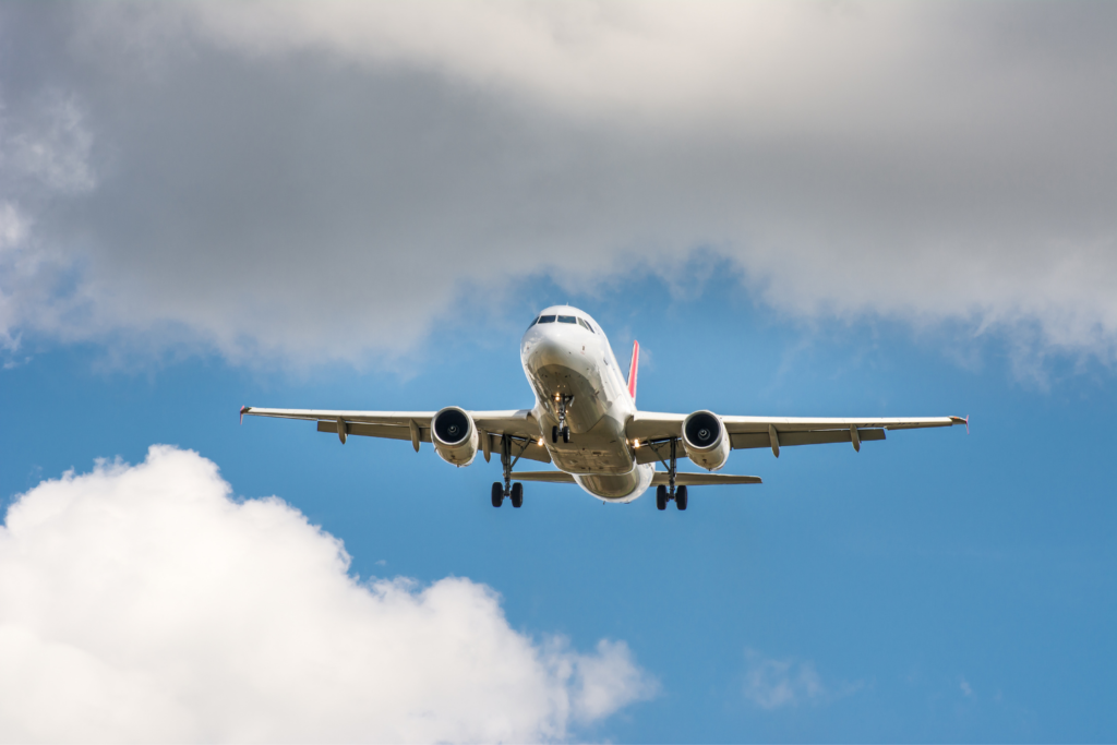 An airplane in the sky seen from the ground. Tips for finding cheap airfare