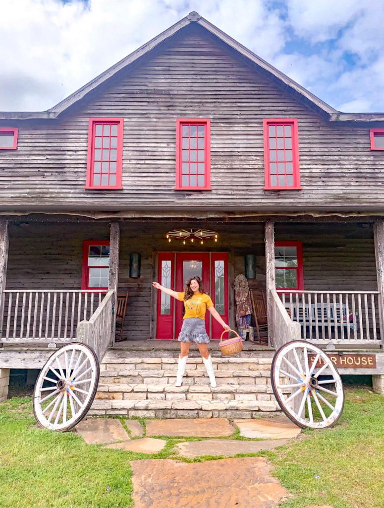 What to pack for a Texas vacation a graphic tee with a gingham skirt and white boots